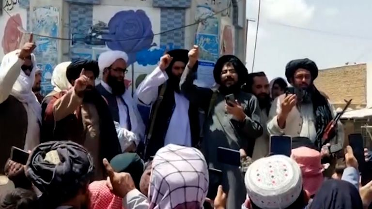 Taliban fighters celebrate as they take over another provincial capital after the US withdrawal