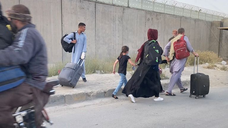 Afghans have been seen walking through the capital with suitcases