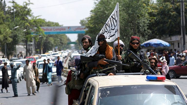 Taliban fighters drive through Kabul brandishing their white flag. Pic: AP