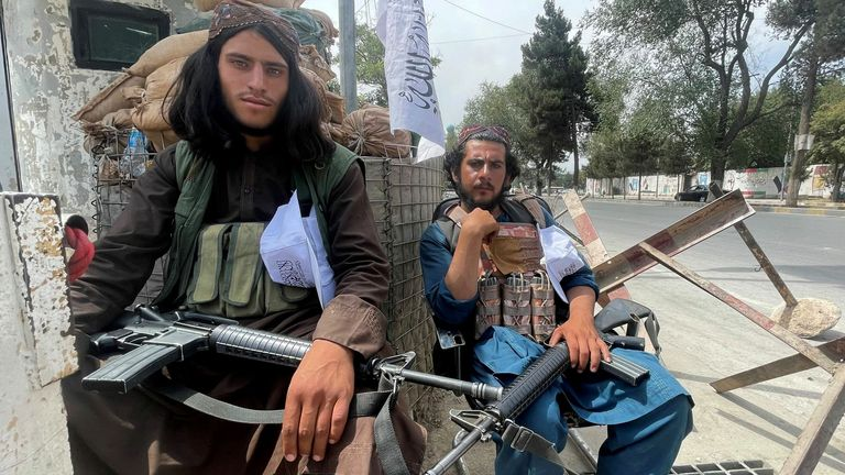 Members of the Taliban man a checkpoint in Kabul on 17 August