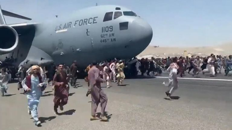 Afghanistan residents cling to plane in desperate bid to leave Taliban-controlled Kabul.