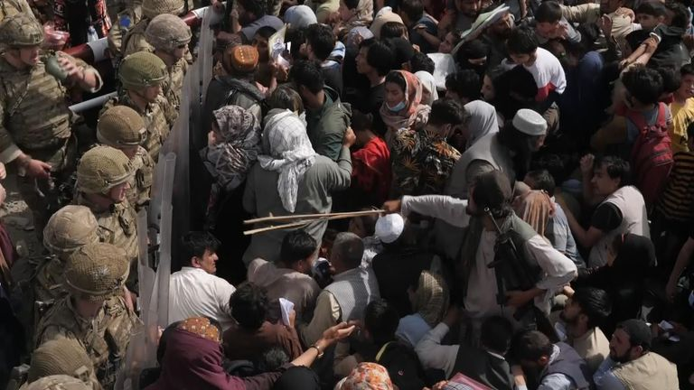 Taliban fighters beat Afghans with canes