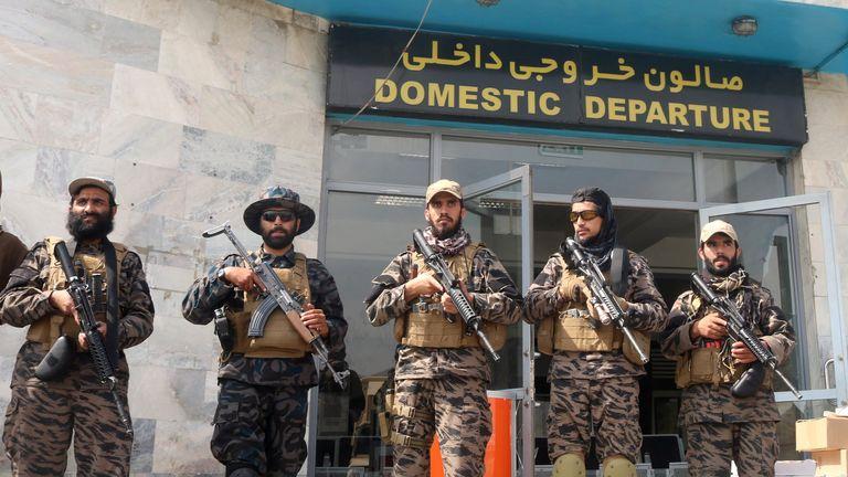 Taliban forces stand guard at Kabul's international airport