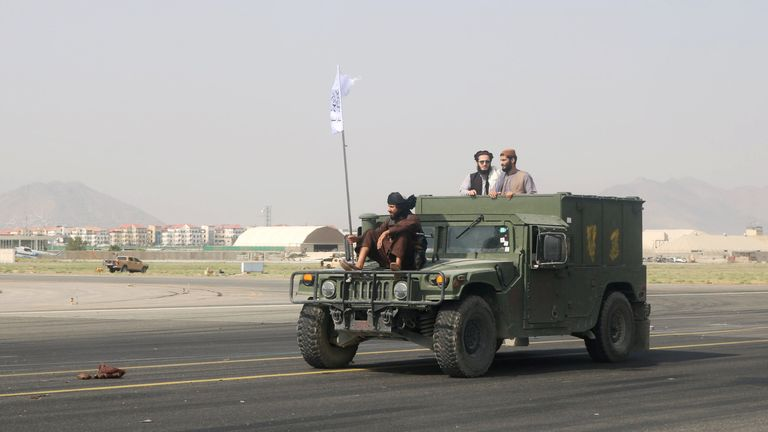 Taliban forces patrol at a runway a day after the U.S. troops withdrawal from Hamid Karzai International Airport in Kabul