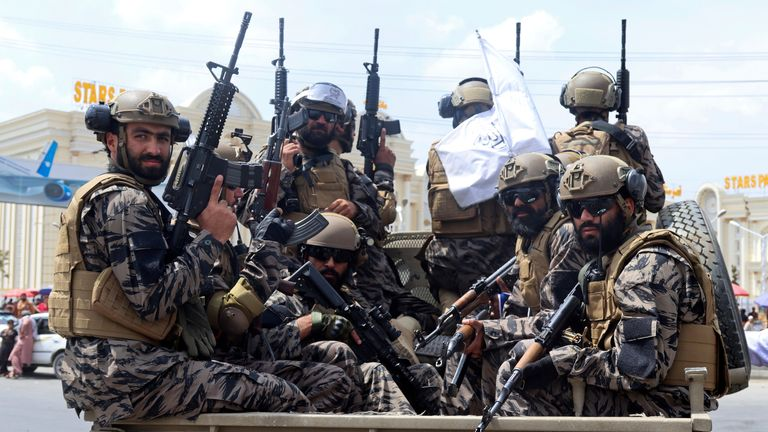 Taliban special force fighters arrive inside the Hamid Karzai International Airport. Pic: AP