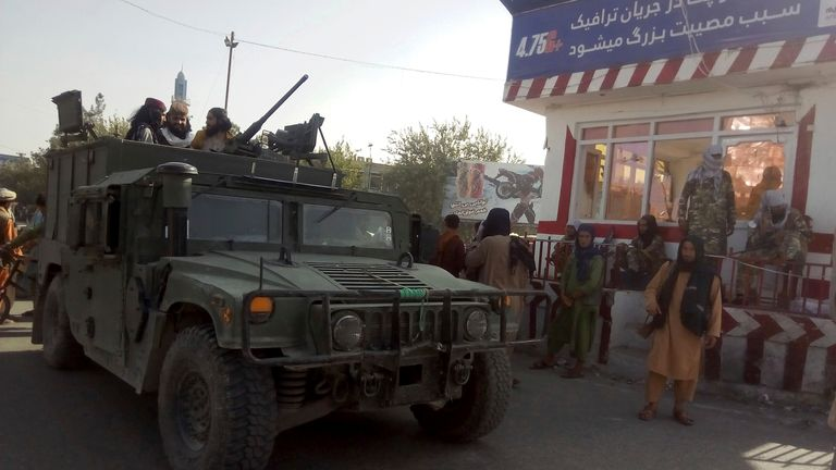 Taliban fighters with an armoured vehicle in Kunduz. Pic: AP