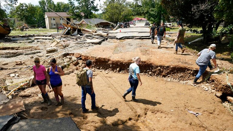 People in Waverly in mid-Tennessee assess the damage after the heavy rainfall caused devastating floods. Pic: AP