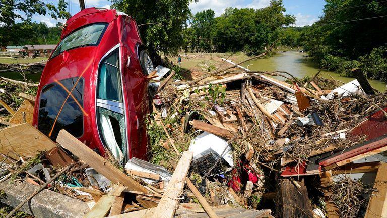 A car is among debris that washed up against a bridge over a stream in Waverly