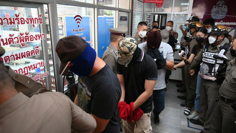 Four wanted policemen are arrive at  Nakhon Sawan police station for interrogation. Pic: AP