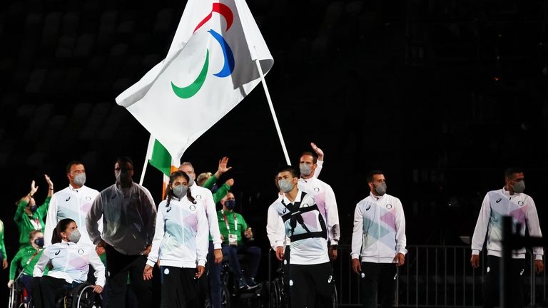 Alia Issa and Abbas Karimi lead the Refugee Paralympic Team during the athletes parade at the opening ceremony of the Tokyo games