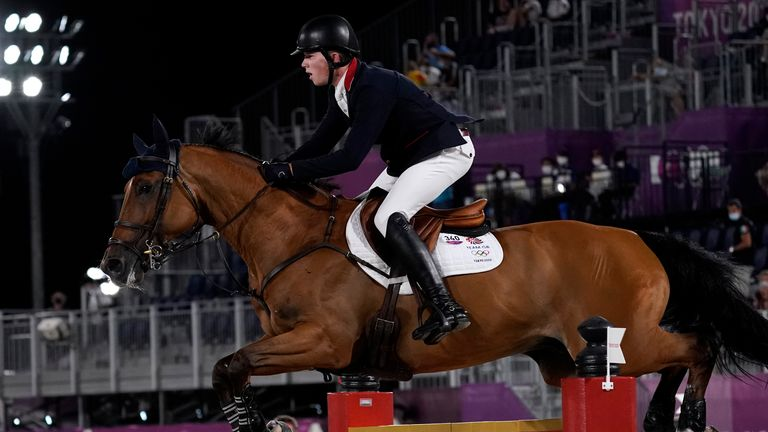 Harry Charles, riding Romeo 88, competes during the equestrian jumping individual final. Pic: AP