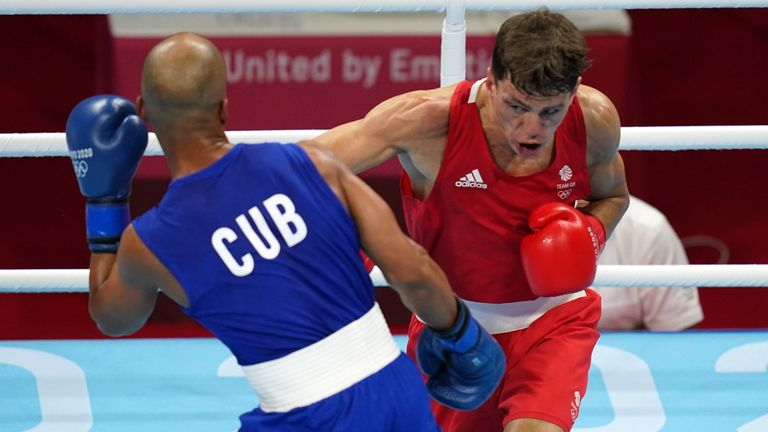 Pat McCormack (red) lost in the 67kg welterweight final to Cuba's Roniel Iglesias