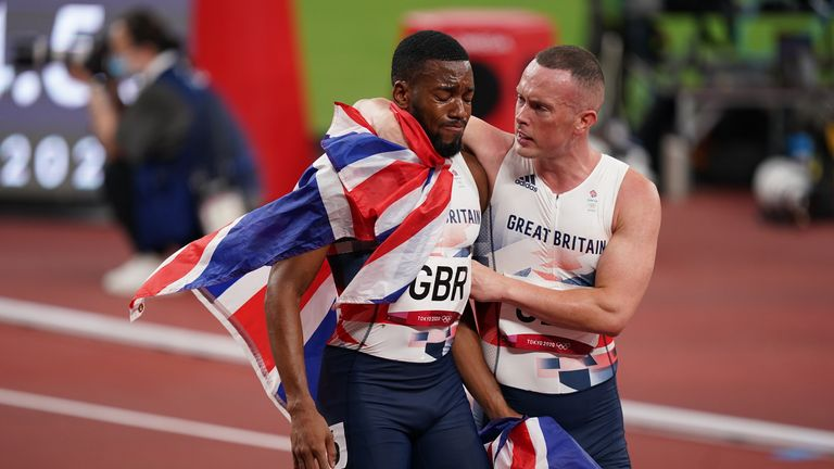Nethaneel Mitchell-Blake is consoled by Richard Kilty after Team GB lost therelay gold medal to Italy