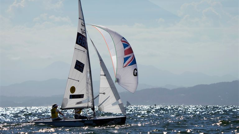 Great Britain's Hannah Mills and Eilidh Mcintyre sail past Mt. Fuji during the women's 470