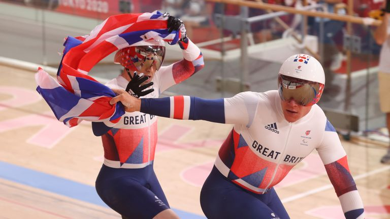 Neil Fachie from Great Britain and his rider Matthew Rotherham (front) are happy about their victory in the Men's 1000m Time Trial B - Visually Impaired at the Izu Velodrome during day four of the Tokyo 2020 Paralympic Games in Japan. Picture date: Saturday August 28, 2021.