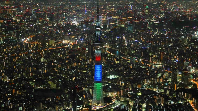 Tokyo Tower (front) and Tokyo Skytree (rear) are lit up by three colors lights for countdown of Tokyo 2020 Paralympic Games in Tokyo on August 25. Pic: AP