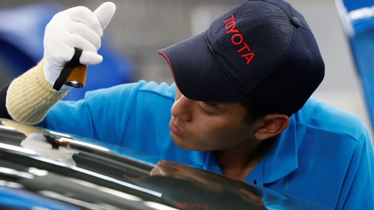 An employee of Toyota Motor Corp. works on the assembly line of Mirai fuel cell vehicle (FCV) at the company's Motomachi plant in Toyota, Aichi prefecture, Japan May 17, 2018. Picture taken May 17, 2018