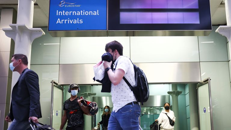 Travellers exit from an arrivals gate at St Pancras International station following the arrival of a Eurostar train from Paris
