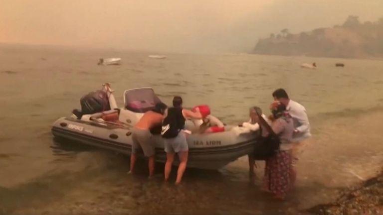 Evacuation of beach at Bodrum in Turkey as wildfire creeps closer Pic: MUGLA TV