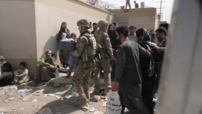 UK armed forces carry baby at Kabul airport