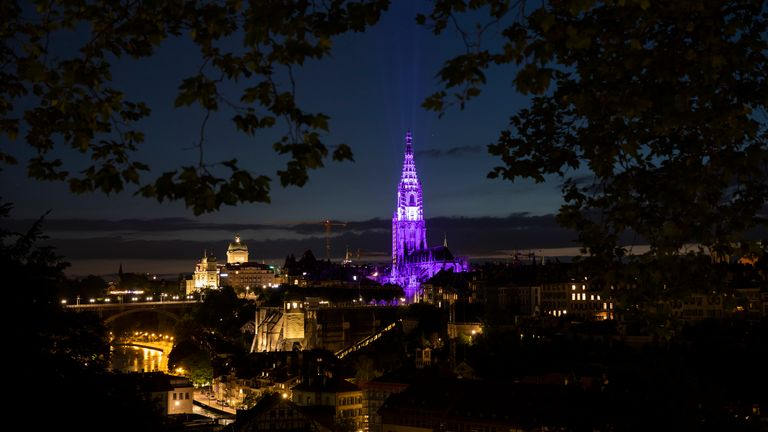 """Münster Cathedral in Bern, Switzerland lit up in purple to highlight """"Wyeth 15"""" Campaign Image: AP"""