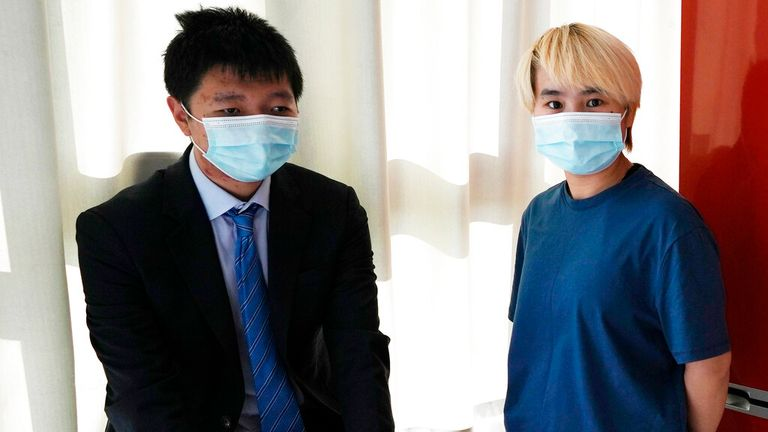 Ms Wu, pictured here with Mr Jingyu, left, claims she was abducted from a hotel in Dubai. Pic: AP