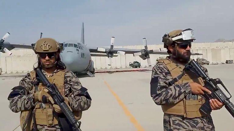 Members of Badri 313 military unit stand guard as Taliban spokesman Zabihullah Mujahid delivers his remarks at Kabul's airport. Pic: Taliban/Reuters