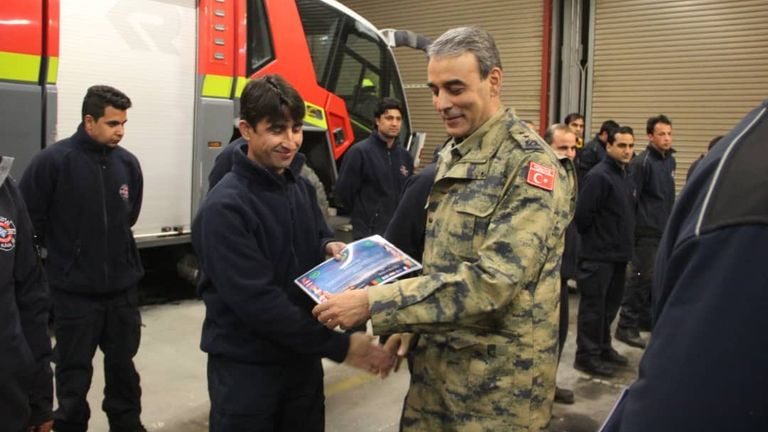 Ziaullah Omer (front left) worked as a firefighter for the British at Kabul Airport