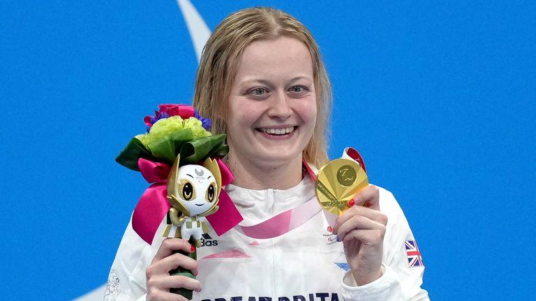 Hannah Russell celebrates on the podium