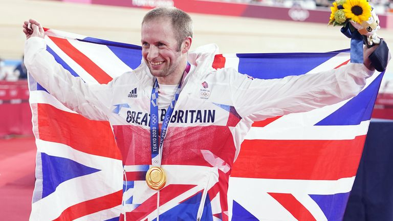 Great Britain's Jason Kenny celebrates with the gold medal in the Men's Keirin Final to become the most decorated British Olympian of all time.