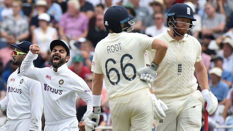 India's Virat Kohli celebrates the dismissal of England's Johnny Bairstow during first day of the first test cricket match between England and India, at Trent Bridge