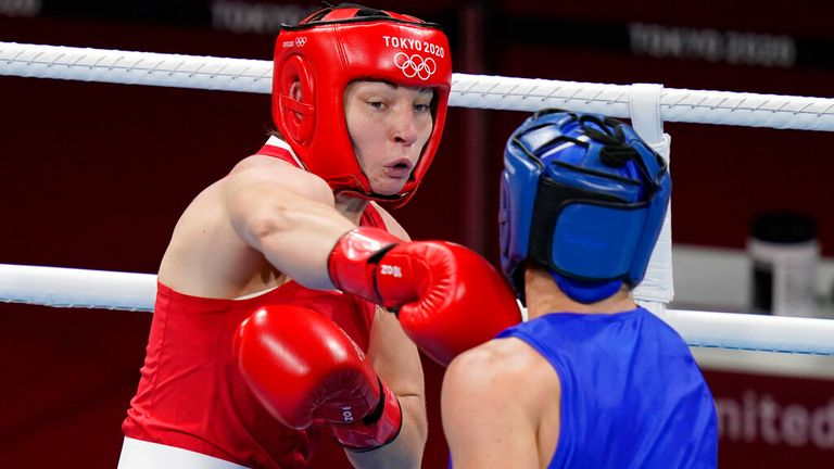 Britain...s Lauren Price, left, exchanges punches with Nouchka Fontlijn, of the Netherlands, during their women...s middleweight 75-kg boxing match at the 2020 Summer Olympics, Friday, Aug. 6, 2021, in Tokyo, Japan. (AP Photo/Frank Franklin II)