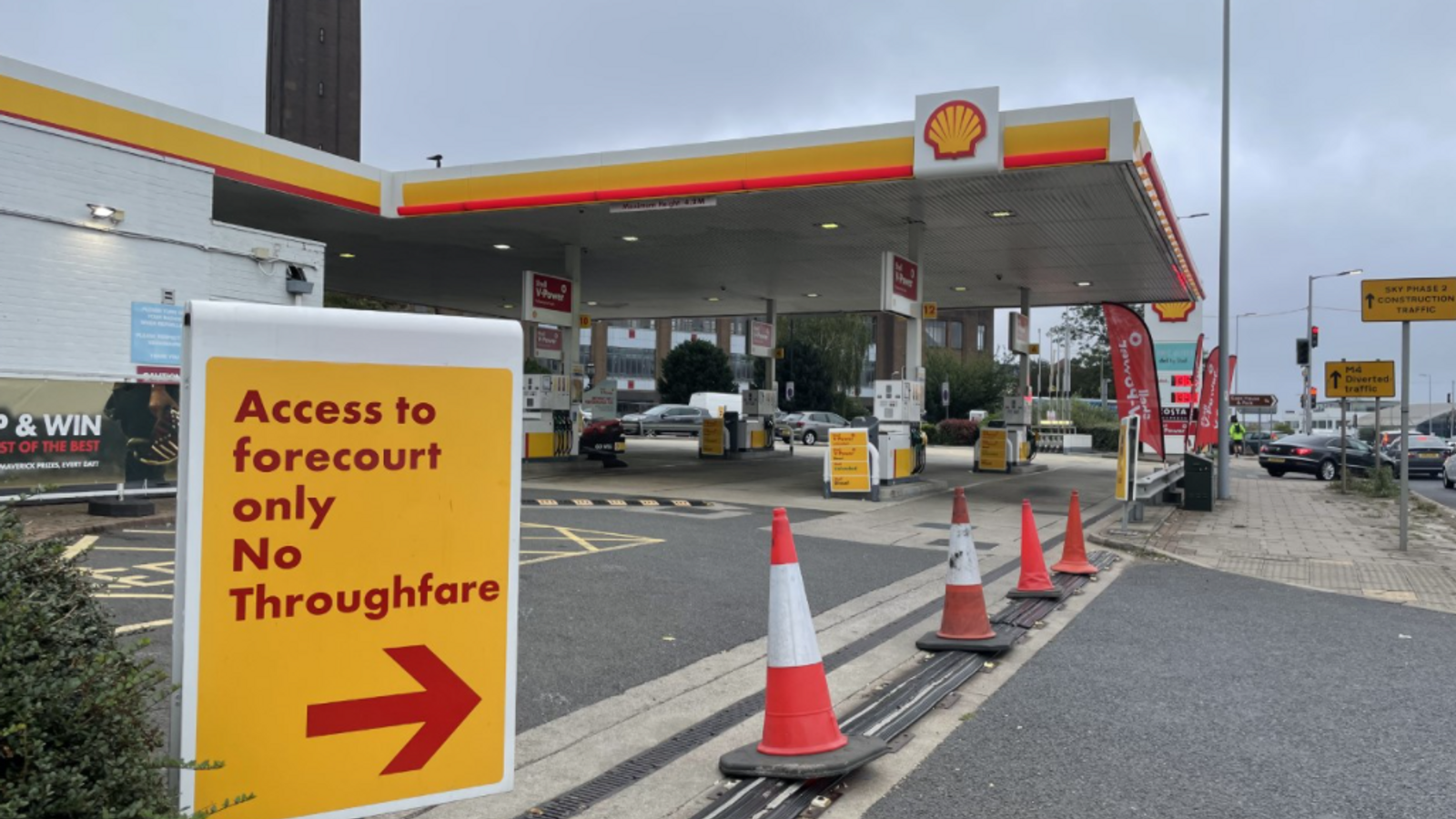 Petrol driver shortage: 'It's stupidity' - Cars spill out on to roads beyond forecourts while waiting for fuel
