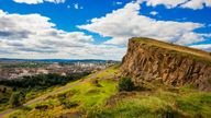 High above the city of Edinburgh loom Salisbury Crags, part of a volcanic formation several million years old known as Arthurs Seat. The spot is popular with walkers and tourists.