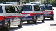 Austrian Police vehicles pictured at the edges of a demonstration along the Reeperbahn in Hamburg, 06 July 2017. The G20 Summit of the heads of government and state takes place on 7 and 8 July 2017 in Hamburg. Photo by: Bodo Marks/picture-alliance/dpa/AP Images