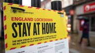 People walk past a Government sign warning people to stay at home on the High street in Winchester, Hampshire, during England's third national lockdown to curb the spread of coronavirus. Picture date: Wednesday January 20, 2021.