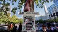 Pictures are seen at the 9/11 Memorial on the 20th anniversary of the September 11 attacks in Manhattan, New York City, U.S., September 11, 2021. REUTERS/Mike Segar