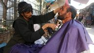 An Afghan man gets his beard trimmed at a street barber shop in Kabul, Afghanistan October 11, 2017. REUTERS/Omar Sobhani