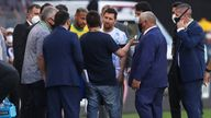 Argentina's Lionel Messi and Brazil's Neymar discuss the situation with officials