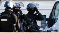 French Gendarmes secure near the Paris courthouse on the Ile de la Cite France during the arrival of a convoy believed to be carrying the defendants who stand trial over Paris' November 2015 attacks, in Paris