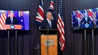 Australia's Prime Minister Scott Morrison, centre, appears on stage with video links Boris Johnson, and Joe Biden at a joint news conference to announce the security alliance Pic: AP