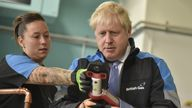 Boris Johnson listens to apprentice Amy Gray during a visit to a British Gas training academy in Leicestershire. Picture date: Monday September 13, 2021.
