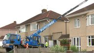 A 'heavy load' - which Sky News understands to be a hot tub - fell from the crane