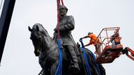 Crew prepares to remove one of the country's largest remaining monuments to the Confederacy, a towering statue of Confederate General Robert E. Lee on Monument Avenue, in Richmond, U.S., September 8, 2021. Steve Helber/Pool via REUTERS TPX IMAGES OF THE DAY