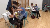 Schoolchildren receive their jabs at Belfairs Academy in Leigh-on-Sea