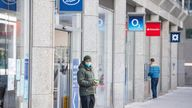 A man wearing a protective face mask exits a Boots branch in central London.
