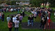 Members of the public attend a vigil at the scene in Chandos Crescent, Killamarsh, near Sheffield