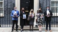 Members of the Covid-19 Bereaved Families for Justice group holding photos of loved ones outside 10 Downing Street after their private meeting with Prime Minister Boris Johnson, 398 days after he first promised to do so