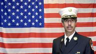Joseph Pfeifer, leader of the first squad of the Fire Department New York (FDNY), stands in front of a US flag during a press conference of the first international congress on the 11 September Terror Attacks, Hamburg, Germany, 26 September 2002 PIC:AP