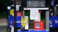 Fuel pumps are out of use at a deserted Esso petrol station forecourt in Solihull, Birmingham
